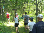 Runners heading out during Woods Walk and Trail Run at Pfeiffer Nature Center