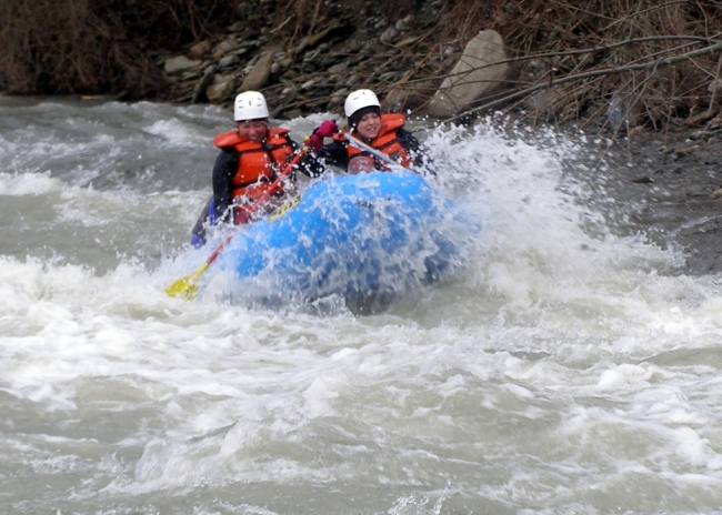 Two women Whitewater rafting on the Cattaraugus Creek. Credit: Rick Miller