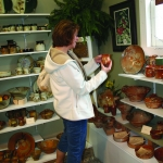 Selecting the perfect item at Hog Shed Studio Pottery