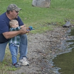Man teaching child to fish
