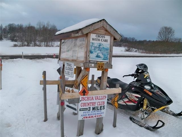 sled and trail sign