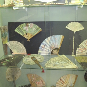 an assortment of antique personal fans