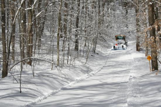 Snowmobile Trail Groomer on a trail at Allegany State Park