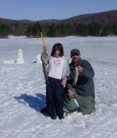 Father and Daughter holding fish they caught ice fishing at Allegany State Park