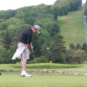Man golfing at Holiday Valley