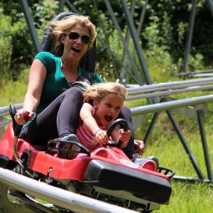 Woman & daughter on Mountain Coaster at Holiday Valley Resort in warm weather