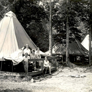 (Old photo) Girls looking out of a platform tent in Allegany State Park