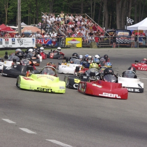 Photo of Go-Karts racing around the track at Chapel Hill Raceway