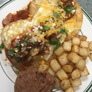 Huevos Rancheros with refrained beans and home fries