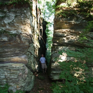 Man between huge rock formations at Little Rock City