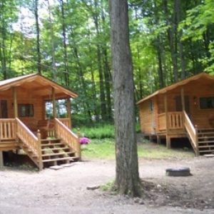 Two of the cabins at Pope Haven