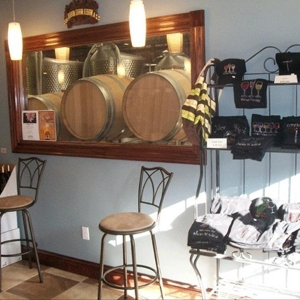Photo of Winery of Ellicottville's interior and wine barrels