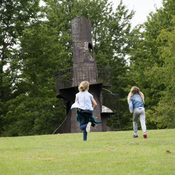 Sisters racing to giant sculpture at Griffis Sculpture Park