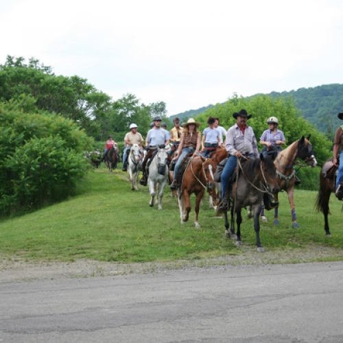 Photo of Jim leading a trail ride