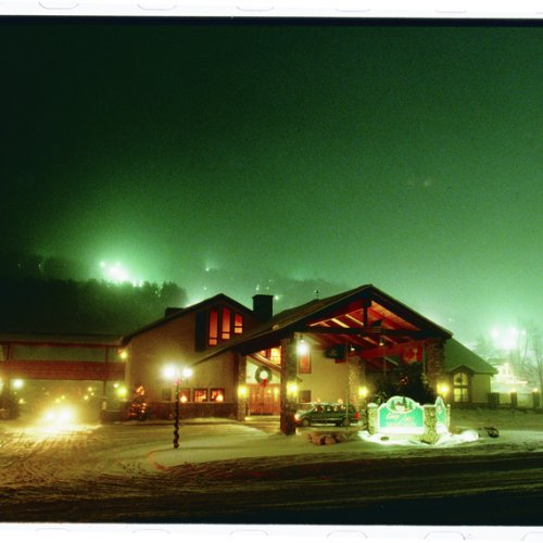 Photo of the Inn at Holiday Valley on a winters night