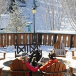 Couple by the fire ring at Holiday Valley Resort