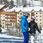 Couple skiing at Holiday Valley Resort