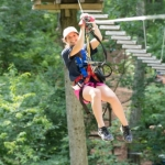 Girl on zipline at Sky High Adventure Park