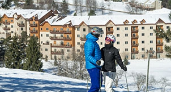 Couple skiing at Holiday Valley Resort