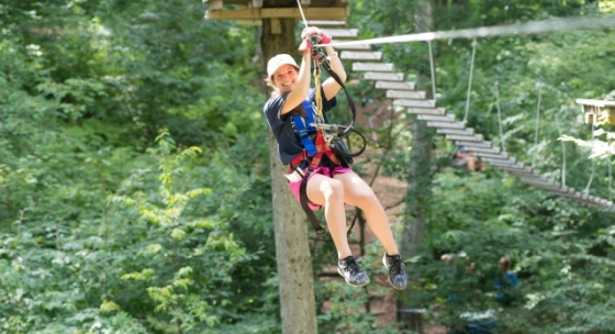Girl on zipline at Sky High Adventure Park