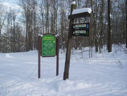Art Roscoe Trail sign with map and trail post
