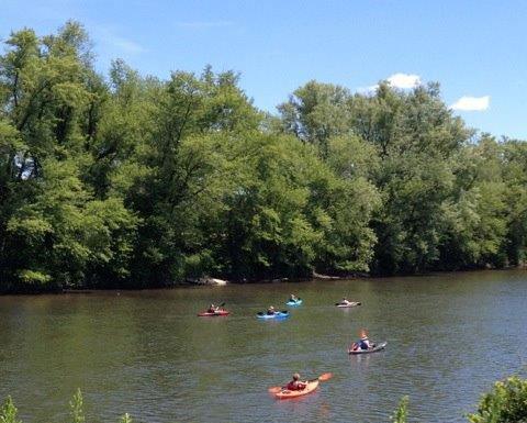 People kayaking on the Allegheny River between Olean and Allegany, NY